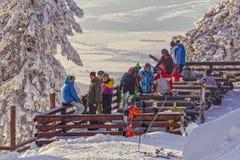 Skiers at Postavaru cottage, Romania Royalty Free Stock Photos
