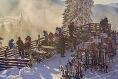Skiers at Postavaru cottage, Romania Stock Photos