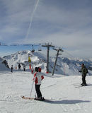 Skiers prepare for their next run Stock Photo
