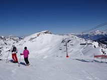 Skiers prepare to descend the piste Stock Images