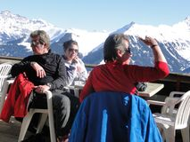 Skiers relax at a high mountain restaurant Stock Image