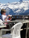 Skiers relax at a high mountain restaurant Stock Photos