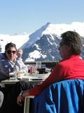 Skiers relax at a high mountain restaurant Royalty Free Stock Images
