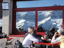 Skiers relax at a high mountain restaurant Royalty Free Stock Image