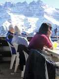 Skiers relax at a high mountain restaurant Royalty Free Stock Photography