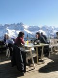 Skiers relax at a high mountain restaurant Stock Photo