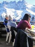 Skiers relax at a high mountain restaurant Stock Photography