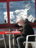 Skiers relax at a high mountain restaurant Royalty Free Stock Photos