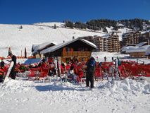 Skiers relax in the sun Stock Images