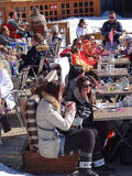 Skiers relax on a sunny deck Stock Image