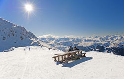 Skiers relaxing on piste Royalty Free Stock Images