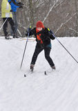 Skiers ride from a hill stock photos