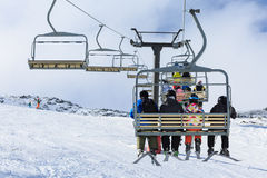 Skiers  ride the ski chair lift Royalty Free Stock Photos
