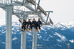 Skiers riding on ski lift in Whistler, Canada Royalty Free Stock Images