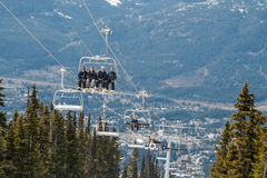 Skiers riding on ski lift in Whistler, Canada Stock Images