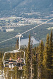 Skiers riding on ski lift in Whistler, Canada. Royalty Free Stock Photography