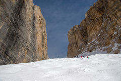 Skiers in Sass Pordoi slope Royalty Free Stock Images