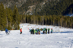 The skiers school training is on slope in Jasna Low Tatras. Stock Photo