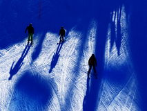 Skiers shadows on snow Royalty Free Stock Images