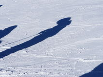Skiers shadows on snow Royalty Free Stock Photo