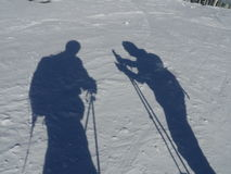 Skiers shadows on snow Stock Images