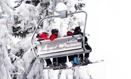 Skiers on ski-lift royalty free stock photos