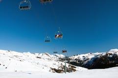 Skiers on ski lift Royalty Free Stock Photos
