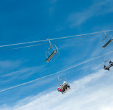 Skiers on ski lift Royalty Free Stock Images