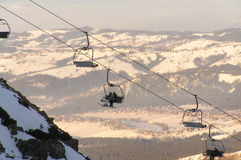 Skiers in the ski-lift. It is High Tatra Mountains on winter Royalty Free Stock Photos