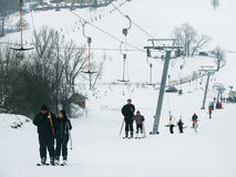 Skiers are on a ski lift (rope tow). Stock Photo