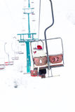Skiers on ski-lift in snow mountains at winter day. cable car li Royalty Free Stock Photography