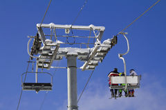 Skiers on a ski lift stock photography