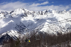Skiers on ski-lift at winter sun day Royalty Free Stock Photo