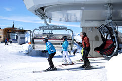 Skiers in ski lift Stock Images