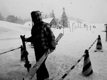 A Skiers on the ski resort. The skiers in black stand on the ski resort. monochrome view Royalty Free Stock Photos