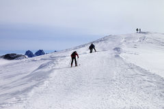 Skiers on ski slope at wind day Stock Image