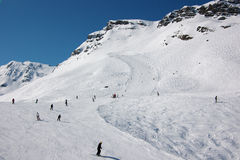 Skiers on ski slopes in French Alps Royalty Free Stock Photo