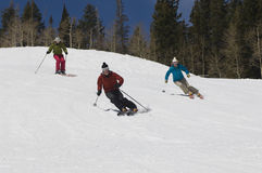 Skiers Skiing Down Slope Royalty Free Stock Image