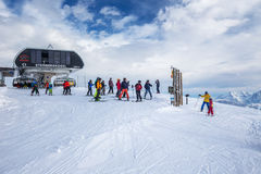 Skiers skiing in Kitzbuehel ski resort in Tyrolian Alps Royalty Free Stock Photo