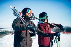 Skiers with skis and poles, extreme lifestyle. Skiers with skis and poles in hands, winter active sport. Skiing from mountains, extreme lifestyle Stock Image