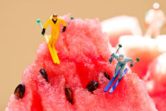 Skiers sliding from watermelon mountains. Creative summer party concept. winter lifestyle, sport activity extreme image. Soft focus stock photos