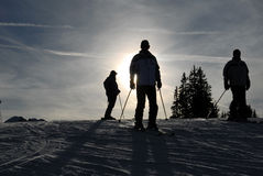 Skiers on the slope. Skiers standing on top of the slope Royalty Free Stock Image