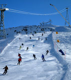 Skiers on slope. Several skiers going down a mountain slope Stock Images