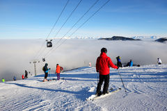 The skiers are on slope and fog in Jasna Low Tatras Stock Images