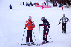 Skiers on the slope in Strbske Pleso ski resort. Slovakia. Royalty Free Stock Photography