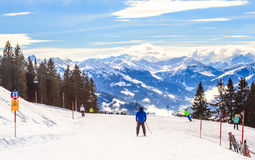 Skiers on the slopes of the ski resort Hopfgarten, Tyrol Royalty Free Stock Photo
