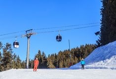 Skiers on the slopes of the ski resort of Meribel. Royalty Free Stock Photos