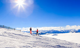 Skiers on the slopes of the ski resort Soll, Tyrol Royalty Free Stock Image