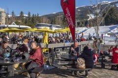 Skiers and snow boarders enjoying apres ski at Whistler ski resort, BC royalty free stock photo