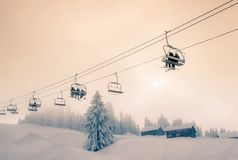 Backlit Chair Lift in Ski Resort Royalty Free Stock Photos